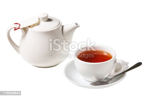 White tea cup with a spoon and a kettle (tea pot) isolated on white background