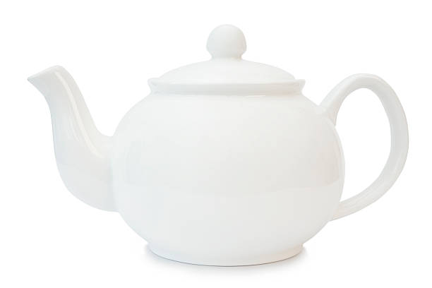 A white tea pot blends into a white background stock photo