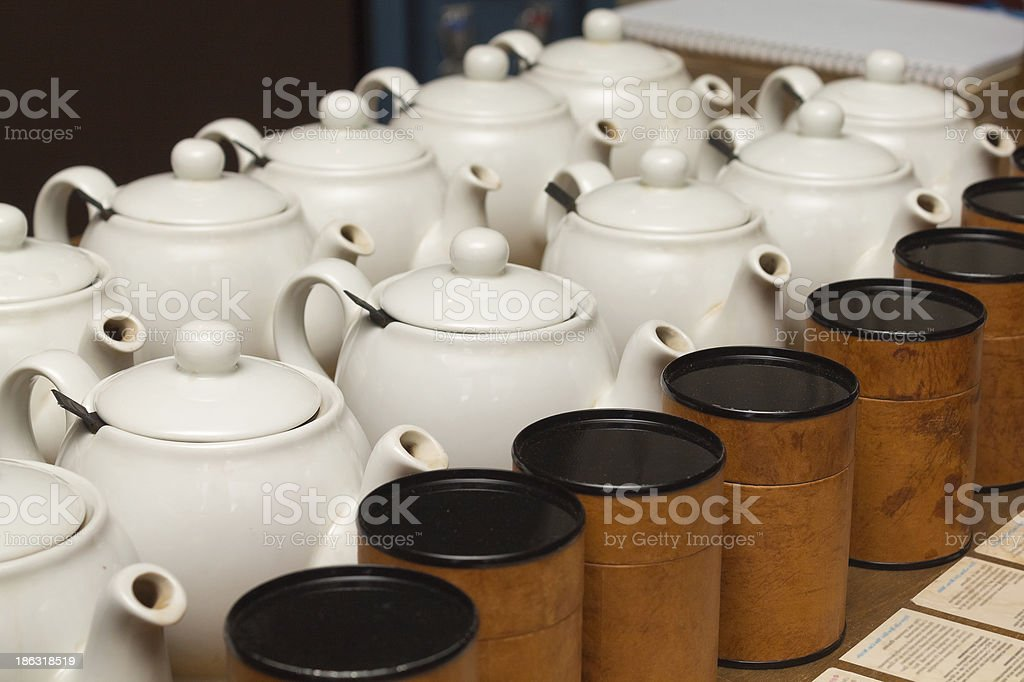 White teapots with tea stock photo