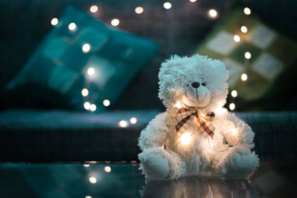 white teddy bear with beautiful bokeh in the background. studio shot of a teddy bear. christmas teddy bear stock pictures, royalty-free photos & images