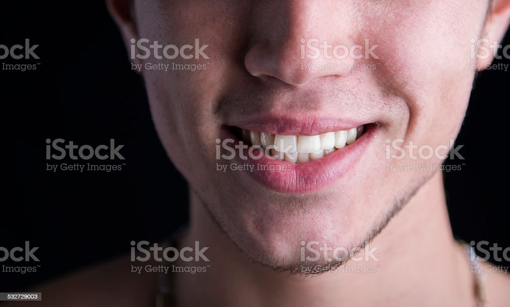 White teeth of a smiling young man stock photo