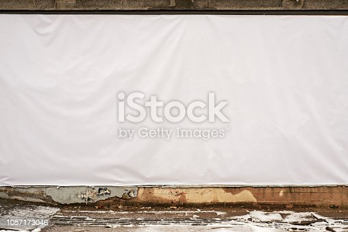 istock White tent on the wall. Facade restoration. 1057173046