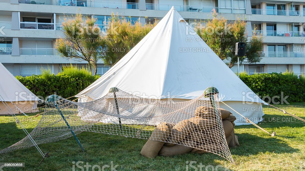 white tent soldiers settled in the city royalty-free stock photo