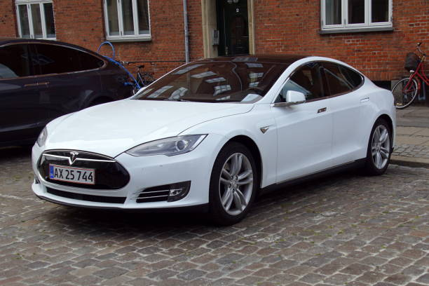 White Tesla Model S Copenhagen, Denmark - July 20, 2019: White Tesla Model S parked on a public parking lot. Nobody in the vehicle. tesla model s stock pictures, royalty-free photos & images