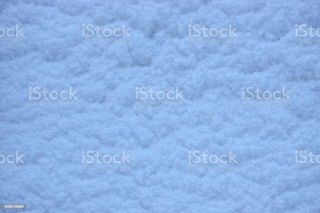 white texture of snow on the surface stock photo