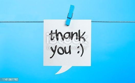 White Thank you Chat Bubble Hanging On Blue Background With the Latch