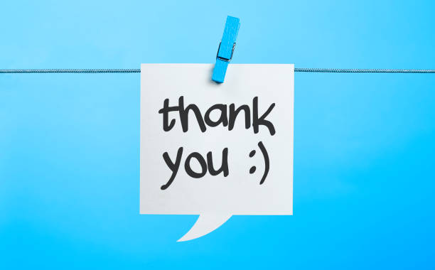 White Thank you Chat Bubble Hanging On Blue Background stock photo
