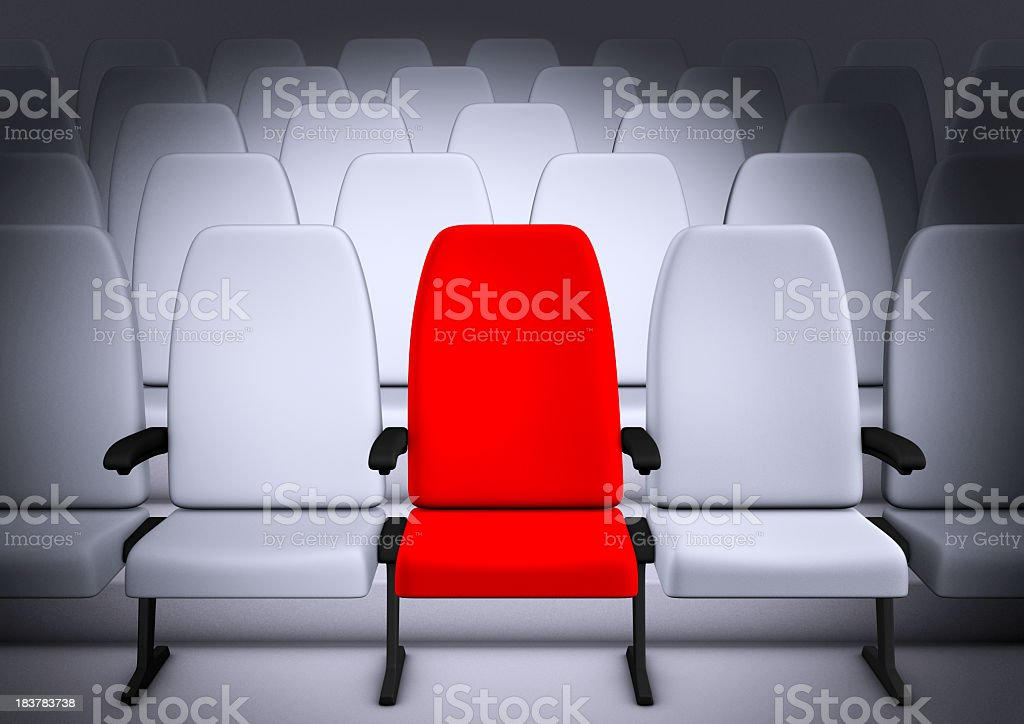 White Theatre style seating with middle chair in red royalty-free stock photo