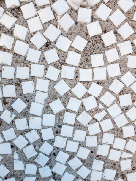 white tile mosaic in gray concrete located in any order - the wall of a panel house a small white tile mosaic in gray concrete located in any order - the wall of a panel house arbitrary stock pictures, royalty-free photos & images