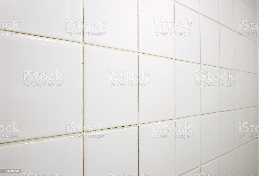 White tiled wall stock photo