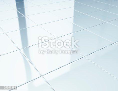 Clean white ceramic tiles on bathroom floor.