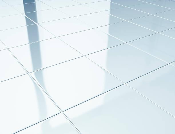 White tiles on a floor in bathroom stock photo