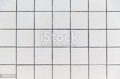 istock White Tiles wall background texture. 988996416