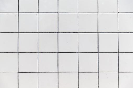 istock White Tiles wall background texture. 988996416