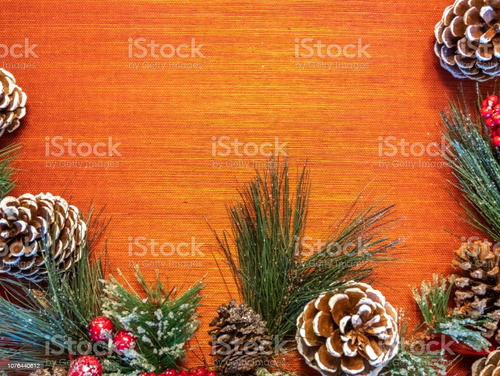 White Tip Pine Cones and Pine wreath On Bright Background With Room...