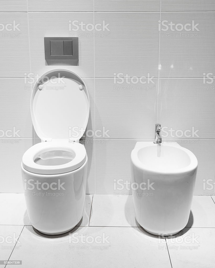 White toilet bowl in a bathroom stock photo