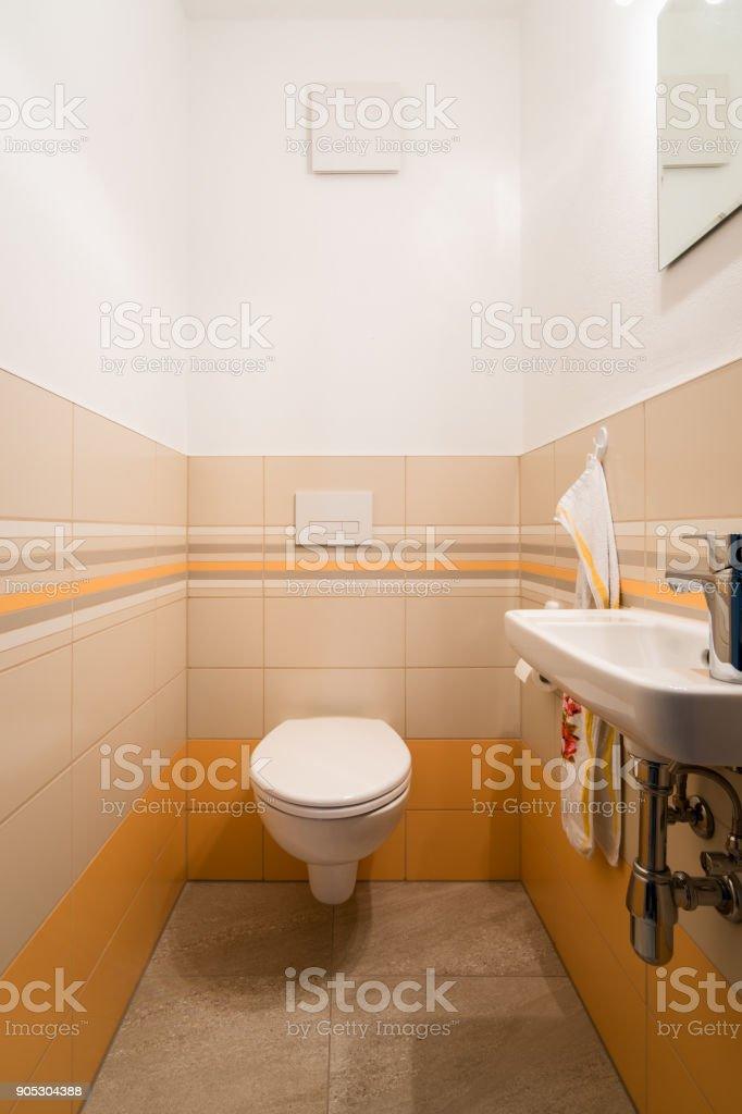 White toilet bowl in a modern bathroom. stock photo