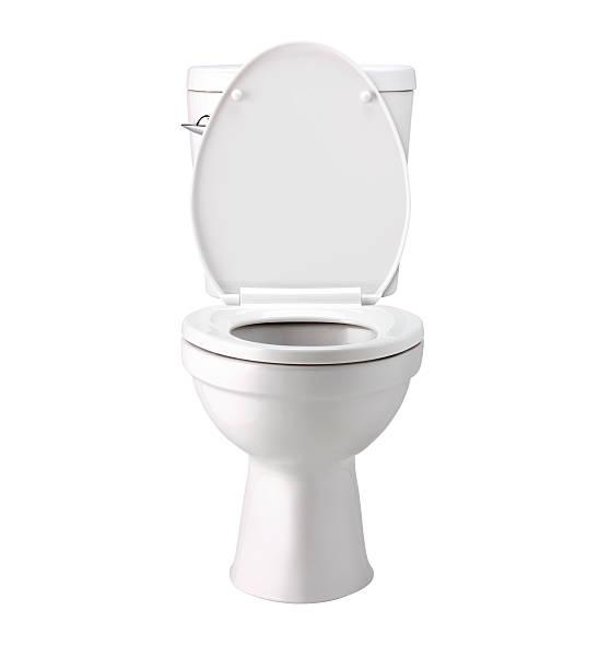 Vaso sanitário em um banheiro branco, isolado com clip caminho - foto de acervo