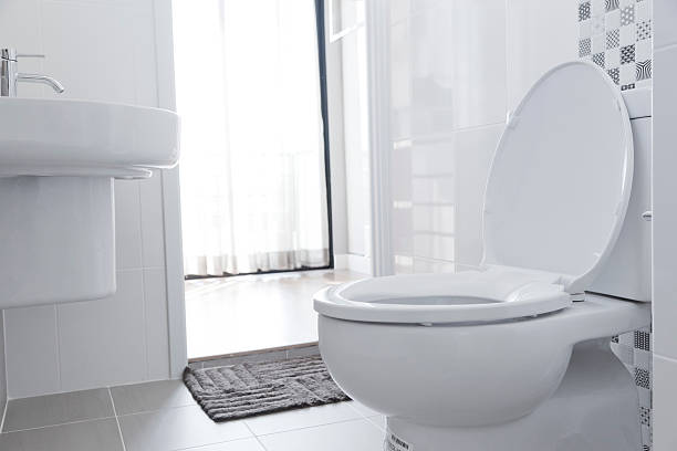 White toilet in home White toilet with water closet look outside flushing water stock pictures, royalty-free photos & images