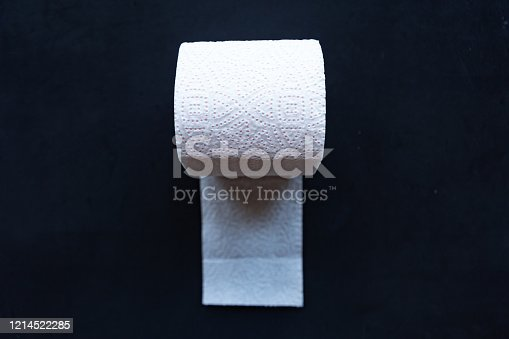 istock White toilet paper roll on black background, hygiene concept. 1214522285
