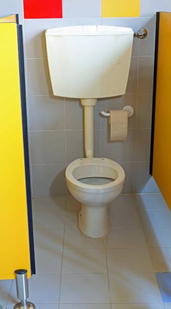 white toilet with toilet paper roll - kindergarten handwerk stock-fotos und bilder