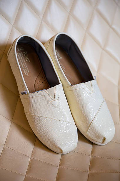 White Toms Shoes for Bride stock photo