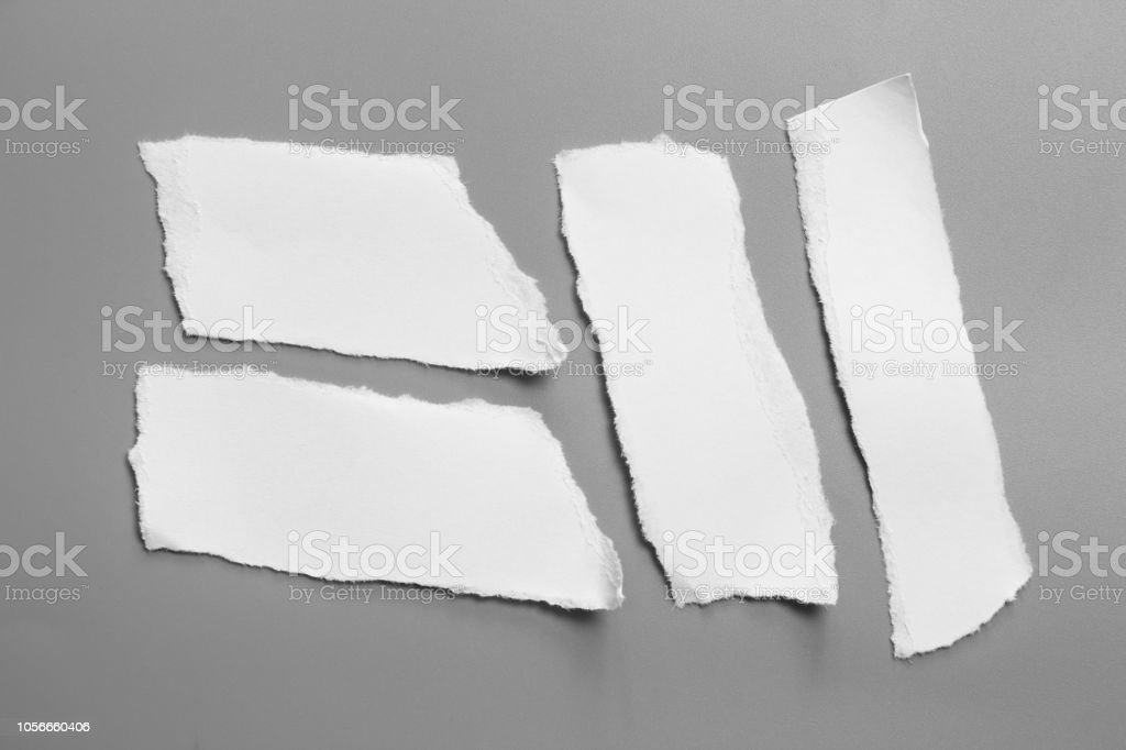 white torn paper on gray background. collection paper rip stock photo