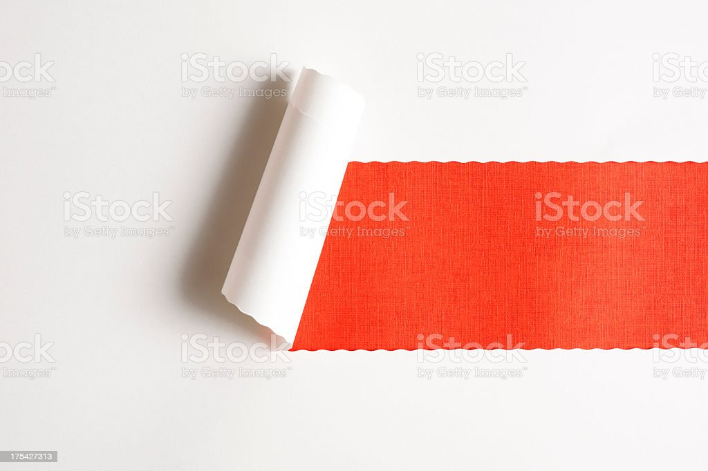 White torn paper on orange paper background royalty-free stock photo