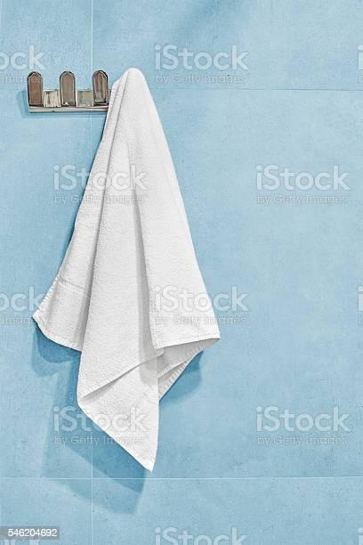 White towel hanging on a wall in bathroom picture id546204692?b=1&k=6&m=546204692&s=612x612&h=e2she75s2ulpwtaypnzwwfacfb6jrxbdjwsgq1zud3c=