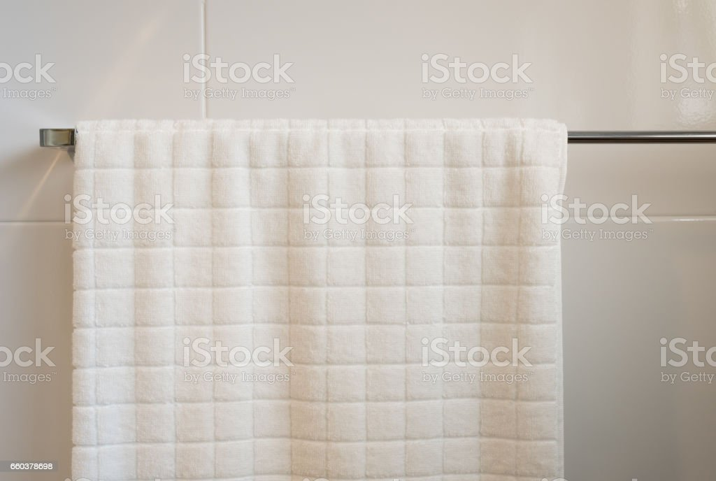 hanging white towel. White Towel Hanging On The Rail Royalty-free Stock Photo