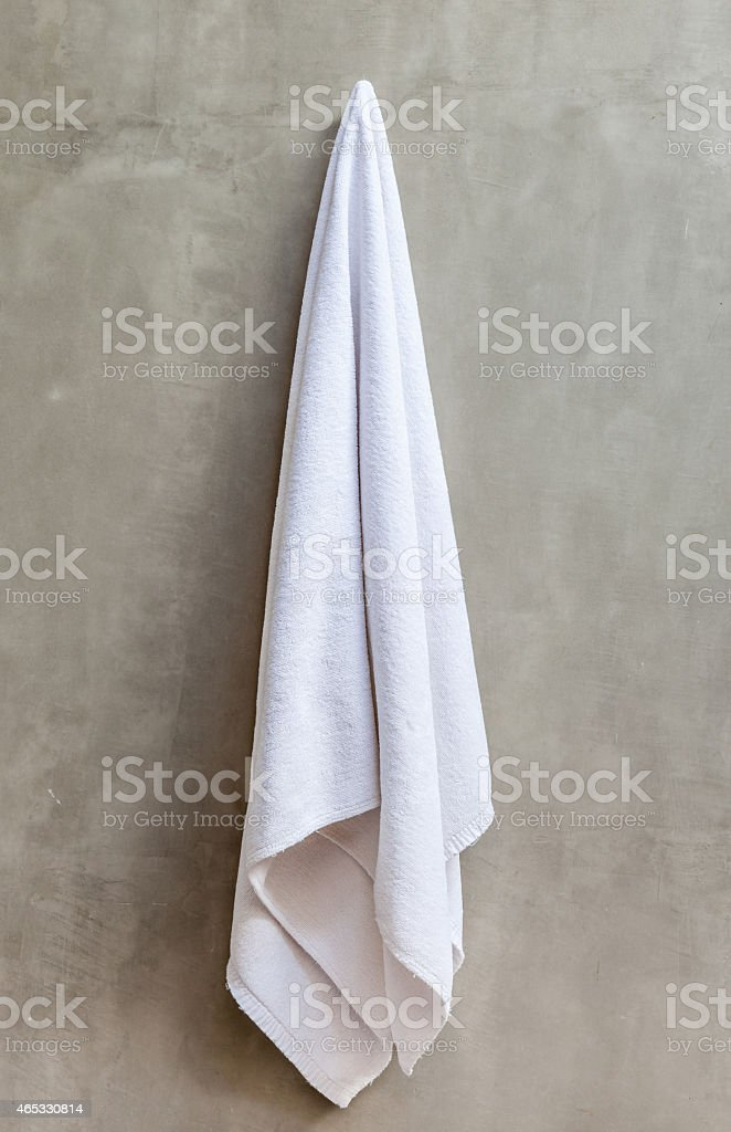 hanging towel. White Towel Is Hanging On The Exposed Concrete Wall Stock Photo E