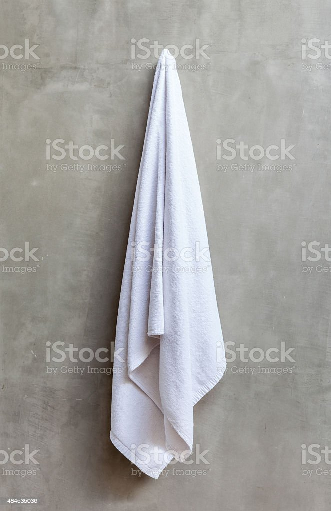 hanging white towel. Hanging White Towel. Simple Towel Is On The Exposed Concrete Wall Stock A