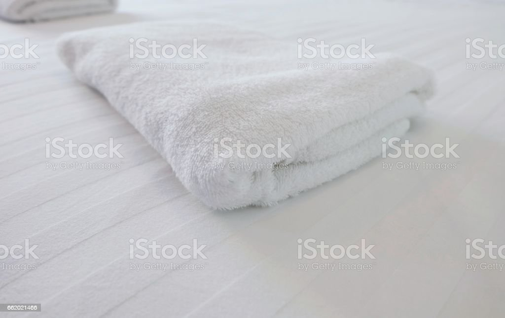 white towel on white bed in bed room royalty-free stock photo