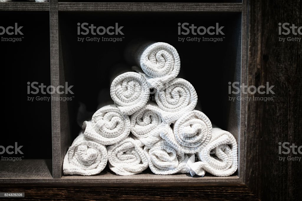 white towel pyramid in a spa and wellness resort stock photo