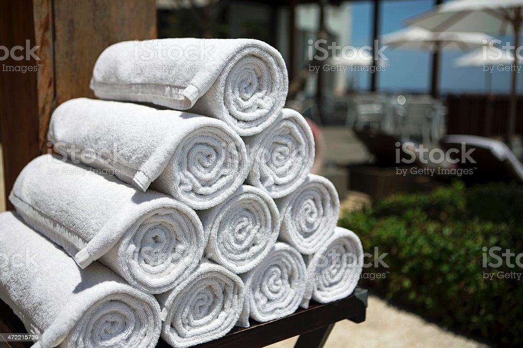 White towels next to swimming pool stock photo