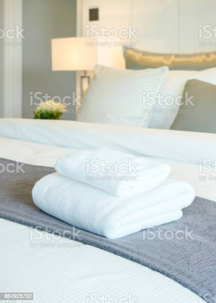 White towels on bed in modern bedroom interior picture id864925732?b=1&k=6&m=864925732&s=612x612&h= q yhtefc76bcy1iw0o  vxv0t43msuulefxnmqvn0w=