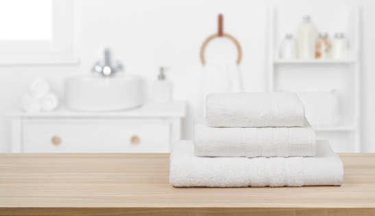 819534860 istock photo White towels on table and copy space over bathroom background 1203126815