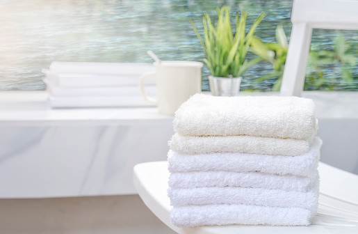 819534860 istock photo White towels on white beach chair with copy space on blurred blue sea background 1057174330