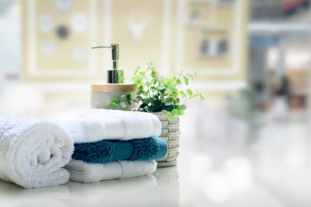 White towels on white top table with copy space. White towels on white top table with copy space on blurred living room background. For product display montage. kitchen counter stock pictures, royalty-free photos & images