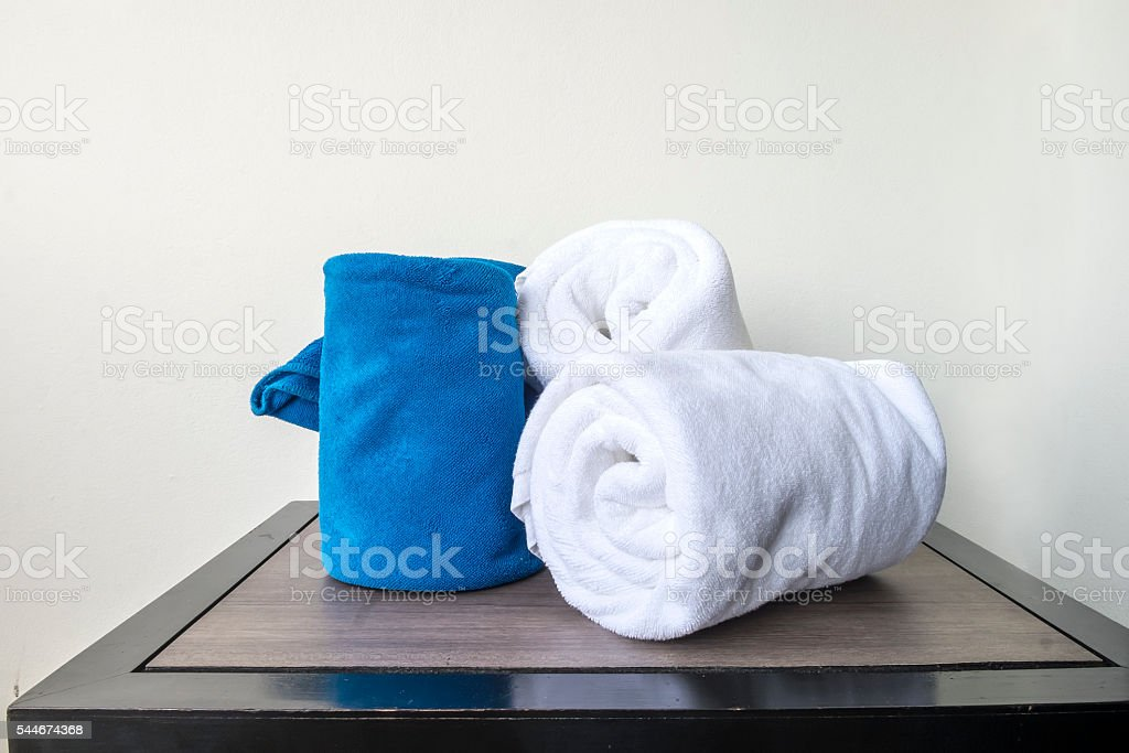 white towels on wood table in bathroon stock photo