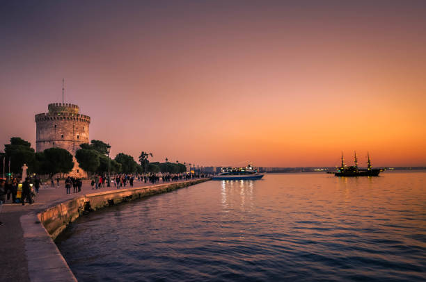 White tower the symbol of Thessaloniki at sunset time-Nikis avenue very crowded. stock photo