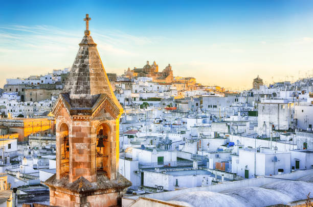 white town Ostuni and cathedral at sunrise stock photo