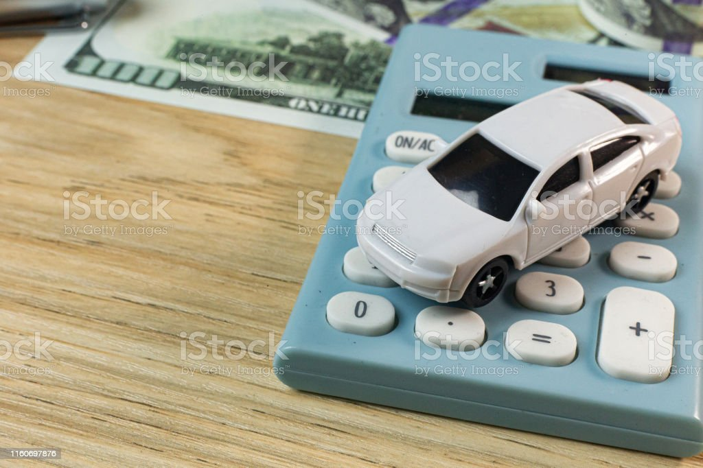 The white toy car on work station table in office.