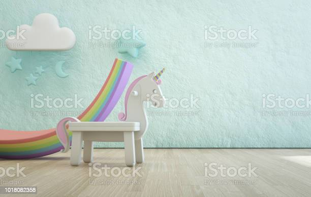 White toy unicorn on wooden floor of kids room with empty rough blue picture id1018082358?b=1&k=6&m=1018082358&s=612x612&h=8ngl1yye5t79dnhcuc3vv0bn zbrv 3k9tbb8hynmd0=
