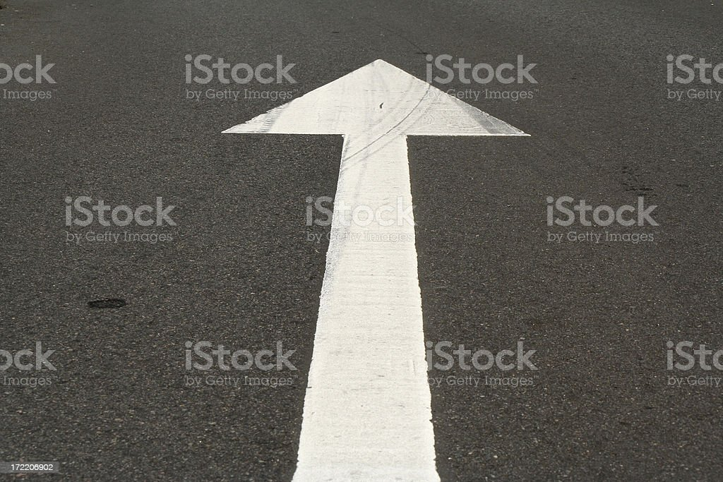 White traffic arrow on the road royalty-free stock photo