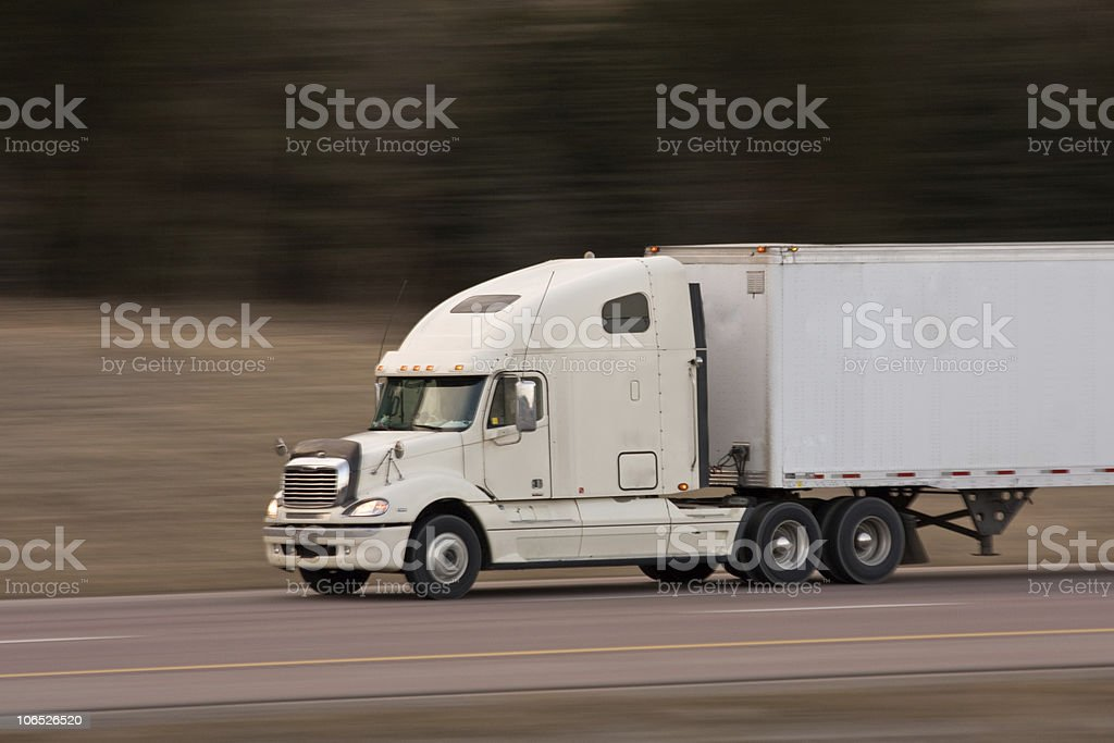 white transport truck rolling on the highway royalty-free stock photo