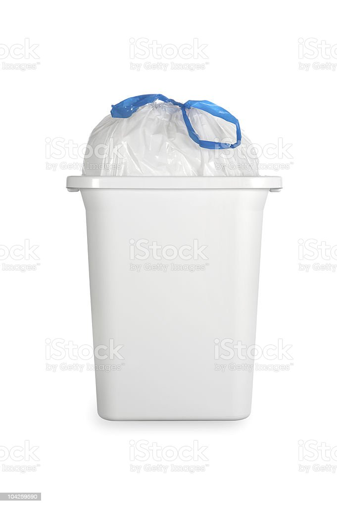 White trash can with plastic garbage bag stock photo