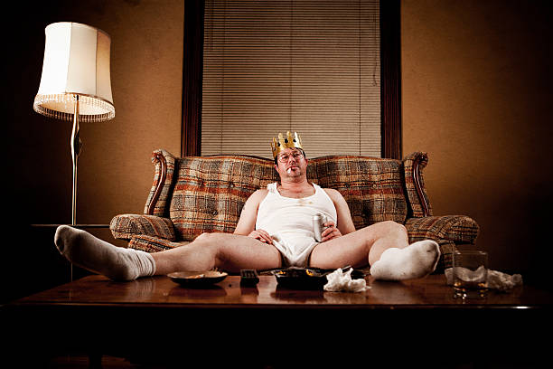 white trash series: king of his castle - laziness stock photos and pictures