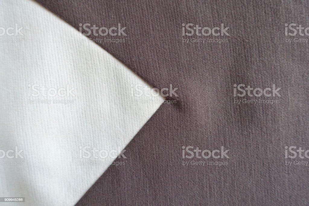 White triangular gusset sewn to brown fabric stock photo