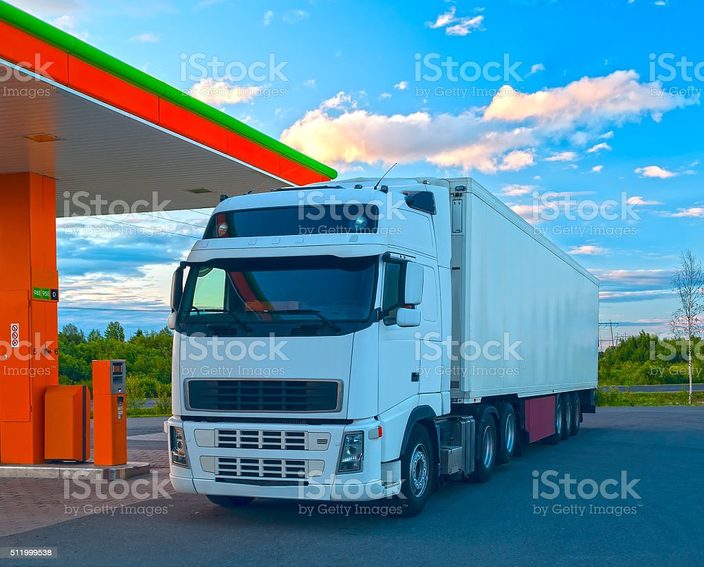 White truck at the fuel station in sunny summer day stock photo